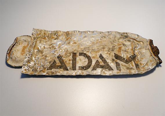 Crushed 'ADAM' deodorant can